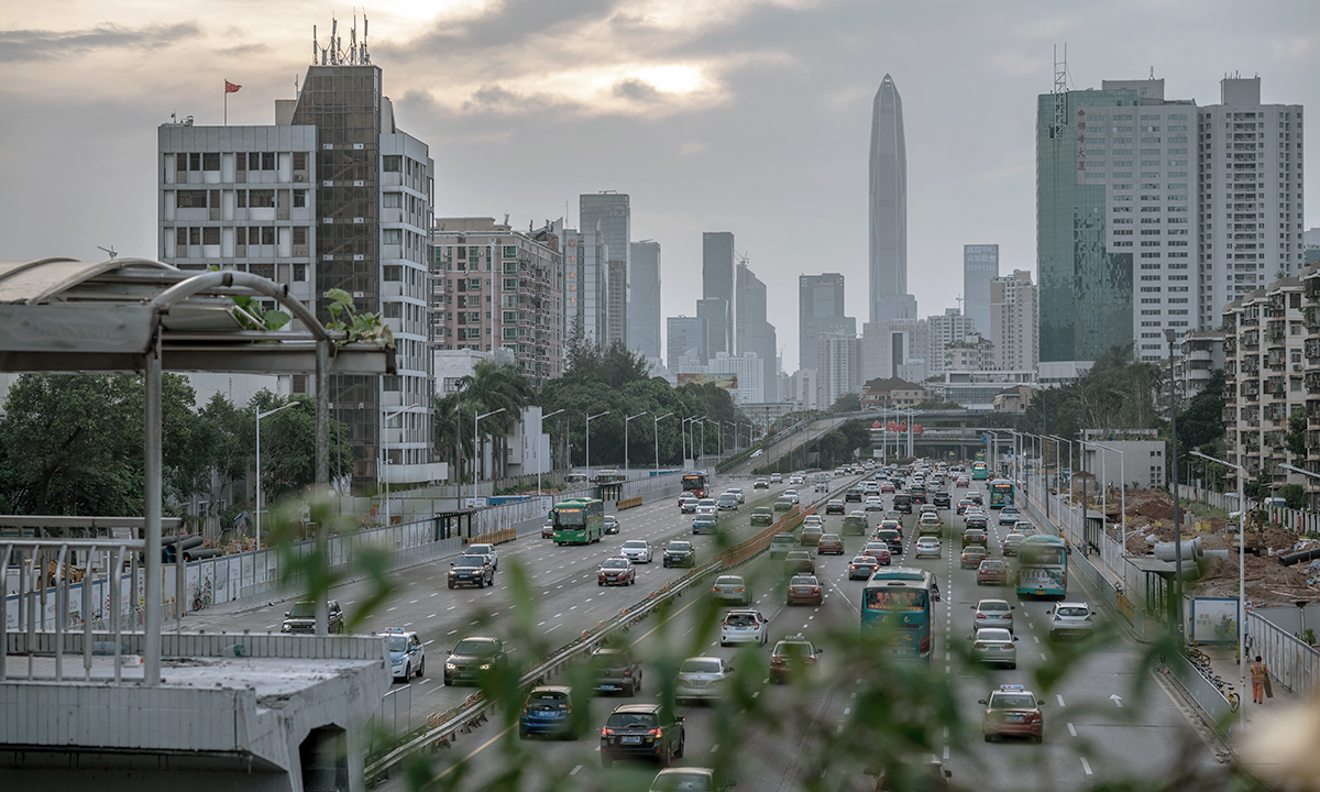 A busy artery feeds traffic into Shenzhen, where the government has converted bus and taxi fleets to electric vehicles.